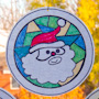 Stained glass Santa medallion