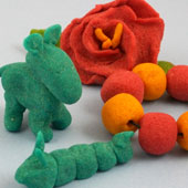 Modeling dough: flower, beads, animals