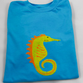 Stenciled seahorse enhanced with liquid embroidery