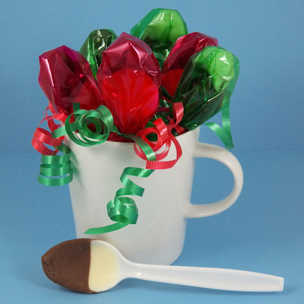 Fancy chocolate spoons in a mug.