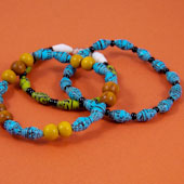 Shiny paper beads made into bracelets