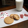 Milk and cookie placemat with snowman and mitten cutouts