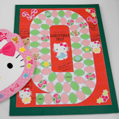 Design-your-own game board in red and green with Hello Kitty stickers