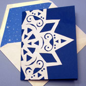 Greeting card decorated with a paper snowflake.
