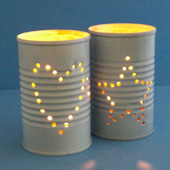 Tin Can Candler Holders with lit candle