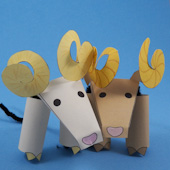 Two bighorn sheep finger puppets
