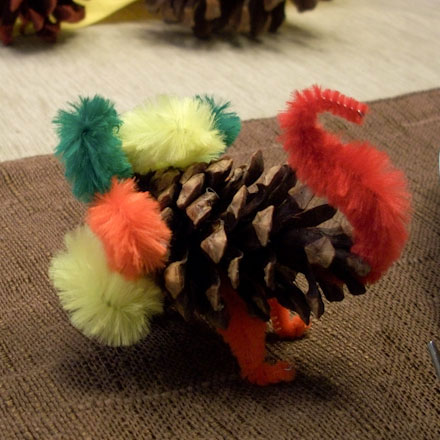 How to make a pine cone turkey thanksgiving crafts for Pipe cleaner turkey craft