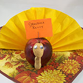 Turkey place card made from an apple and a napkin